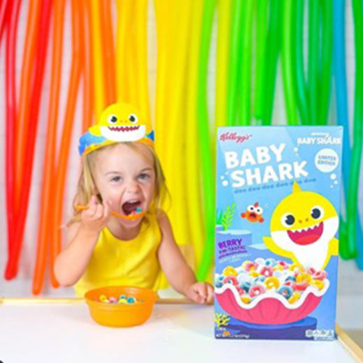 girl eating baby shark cereal