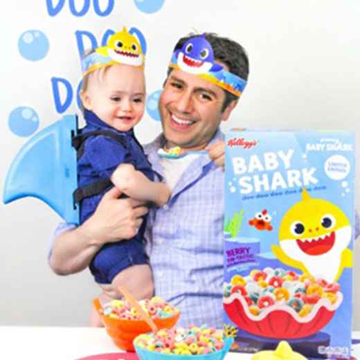 dad and son with Baby Shark cereal